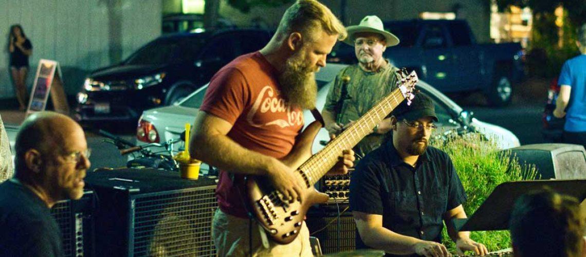 man holding guitar playing